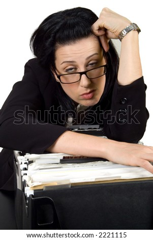 Female hanging over file crate looking sleepy - stock photo