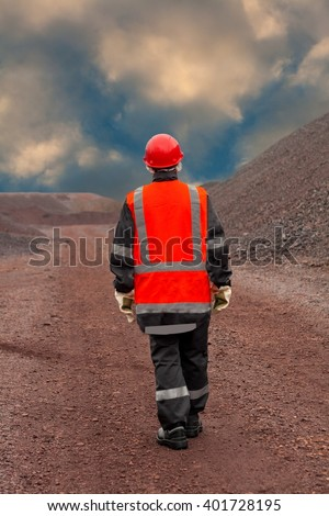 Female hard work. harmful production. mining industry. clothes. warehouse. waste. ore. raw materials. Dust content of air. Harmful air. The woman in protective working clothes. labor protection - stock photo