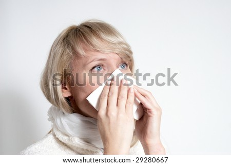 female having a cold. Isolated - stock photo