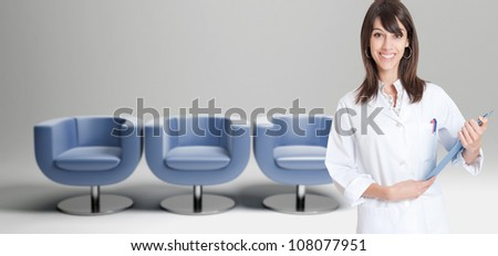 Female healthcare worker and a row of chairs in the background - stock photo