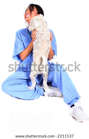 Female Healthcare Worker or Veterinarian with Dog - stock photo