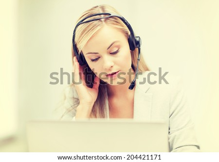 female helpline operator with headphones and laptop - stock photo