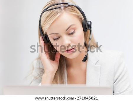 female helpline operator with headphones and laptop - stock photo
