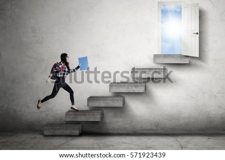Female high school student running on the stairs leads to an opportunity to success