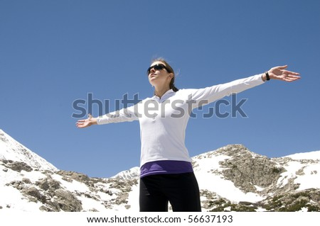 Female hiker celebrating a successful climb