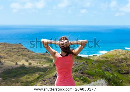 Female hiker enjoying the beautiful view. (Location Hawaii) - stock photo