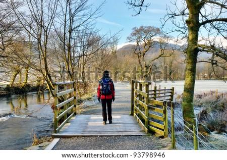 Female Hiker Frosty Winter Morning - stock photo