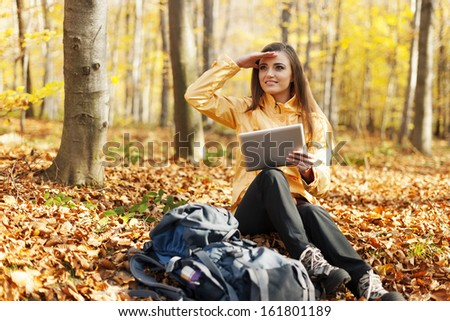 Female hiker has break and looking for something - stock photo