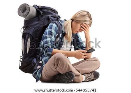Female hiker holding her head in disbelief and looking at a mobile phone isolated on white background