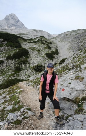 Female hiker in the alps. - stock photo