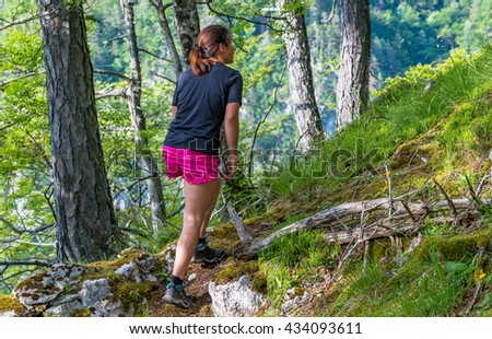 Female hiker on a rocky path in the forest