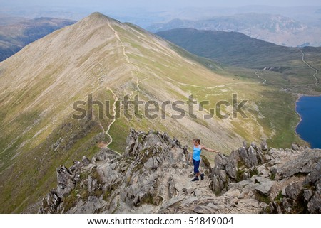 Female hiker on a trail in the Lake District National Park in the North of England