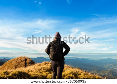 Female hiking in the mountains - stock photo