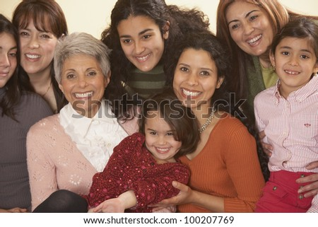 Female Hispanic family members smiling