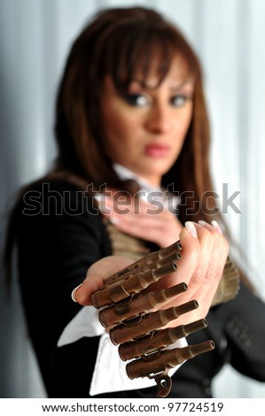 Female holding a bullet belt - stock photo