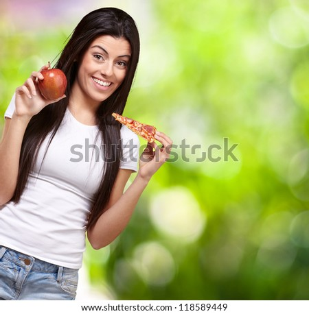 Female Holding A Piece Of Pizza And A Apple, Background