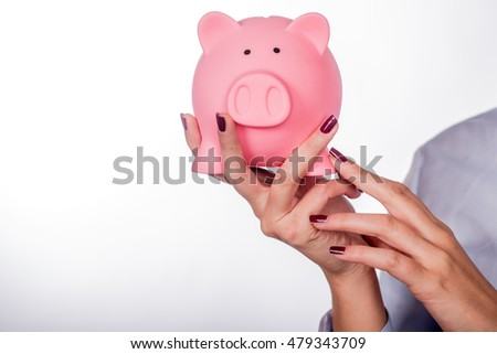 Female holding a pink piggy bank