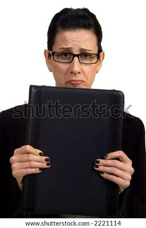 Female holding briefcase looking troubled - stock photo