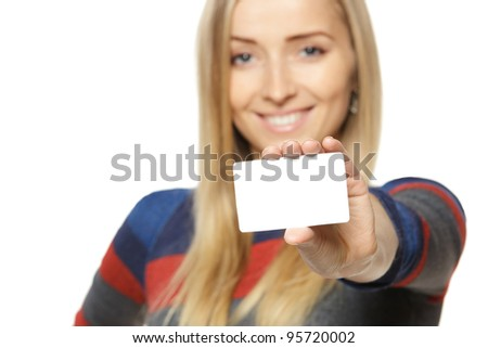 Female holding credit card, shallow depth of field, focus on the credit card, over white background - stock photo