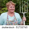 female holding garden tool outside working - stock photo