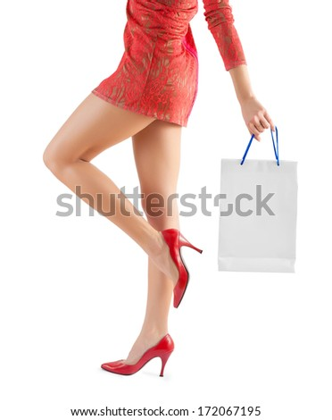 female holding paperbag very close up - stock photo