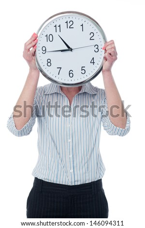 Female holding wall clock in front of her face