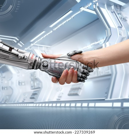 female human and robot's handshake as a symbol of connection between people and artificial intelligence technology - stock photo