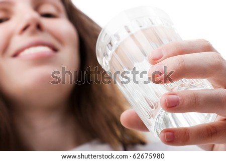 Female human hand holding liquid drink water glass