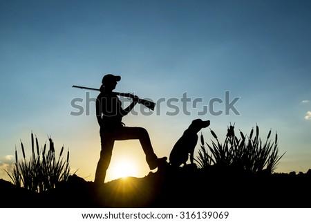 Female Hunter in Sunset - stock photo