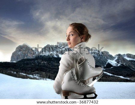 female ice skater portrait against a mountain landscape - stock photo