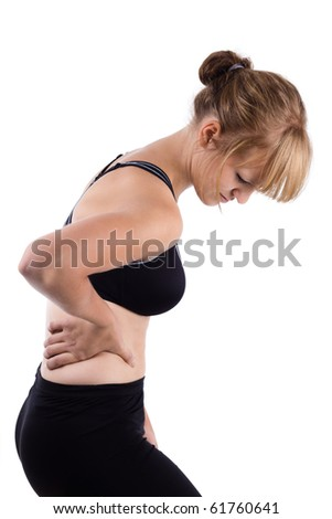 Female in black holding lower back in pain - stock photo