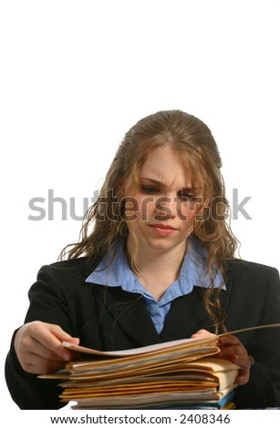 Female in business attire looking seriously at files - stock photo