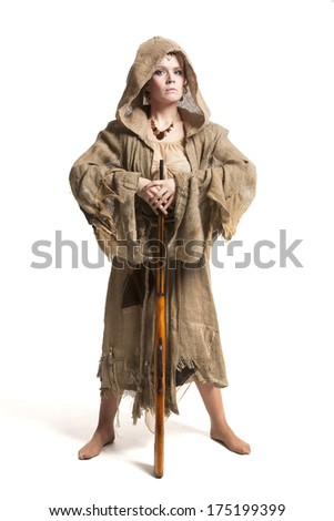 female in costume of savage woman with gun - stock photo
