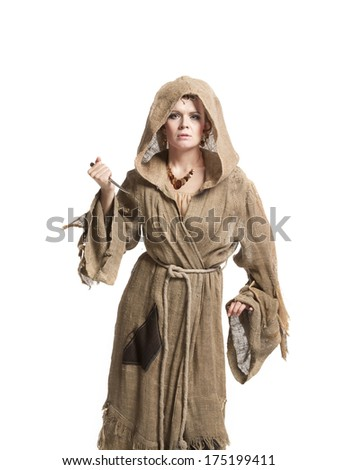 female in costume of savage woman with knife - stock photo