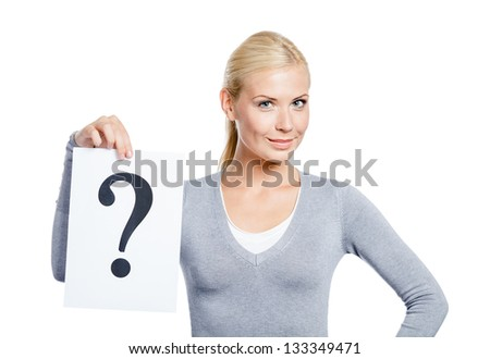 Female in grey sweater keeps paper with question mark, isolated on white - stock photo