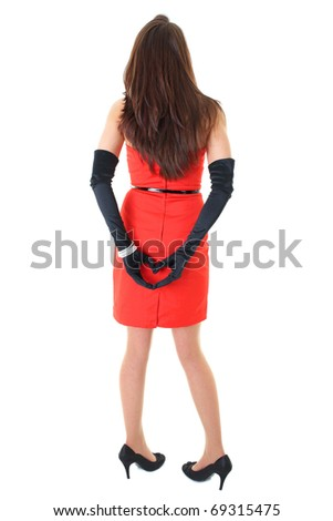 female in red dress with hands in the shape of heart, isolated studio shoot - stock photo