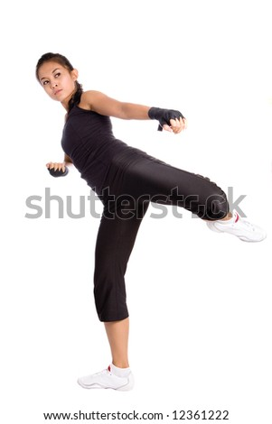 Female in side kick position as part of keep fit exercise training.