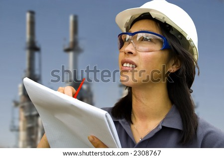 Female Inspector/Engineer with industrial background - stock photo