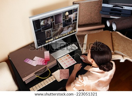 Female interior designer at her workplace. Details for interior design project at monitor. - stock photo