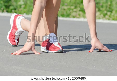 Female is ready to sprint. Sport concept. - stock photo