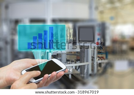 Female is using the smart phone Blank transparent rectangle with growth graph radiates from the screen pf  phone. The edges of the pictures are deliberately blurred. - stock photo