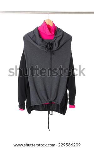 female jacket hanging on wooden hangers  - stock photo