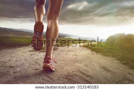 Female Jogger on coastal path - stock photo