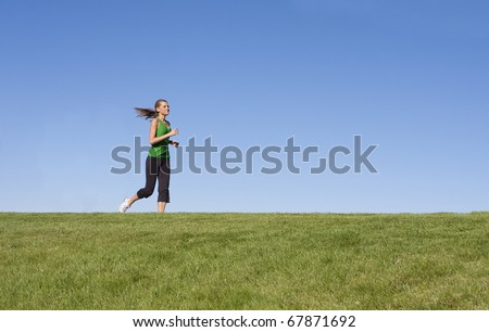 Female Jogger on the horizon (copy space)