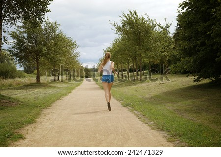 female jogger seen from behind vintage style - stock photo