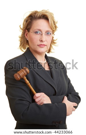 Female judge in jacket posing with hammer - stock photo