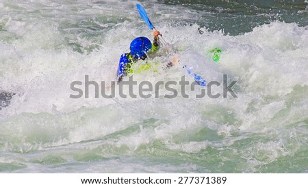Female kayaker in the white water of tghe river - stock photo