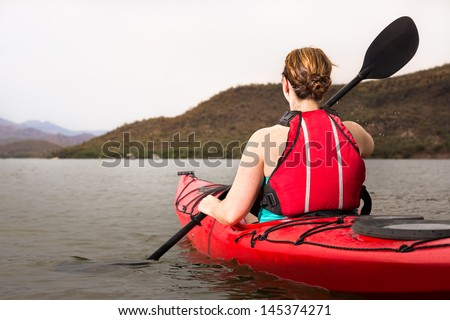 Female Kayaker on Desert Lake - stock photo