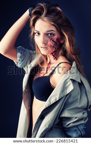 Female  killer or butcher, halloween theme. - stock photo