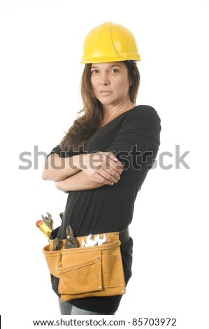 female lady contractor builder with protective hard hat helmet and tool belt tools - stock photo